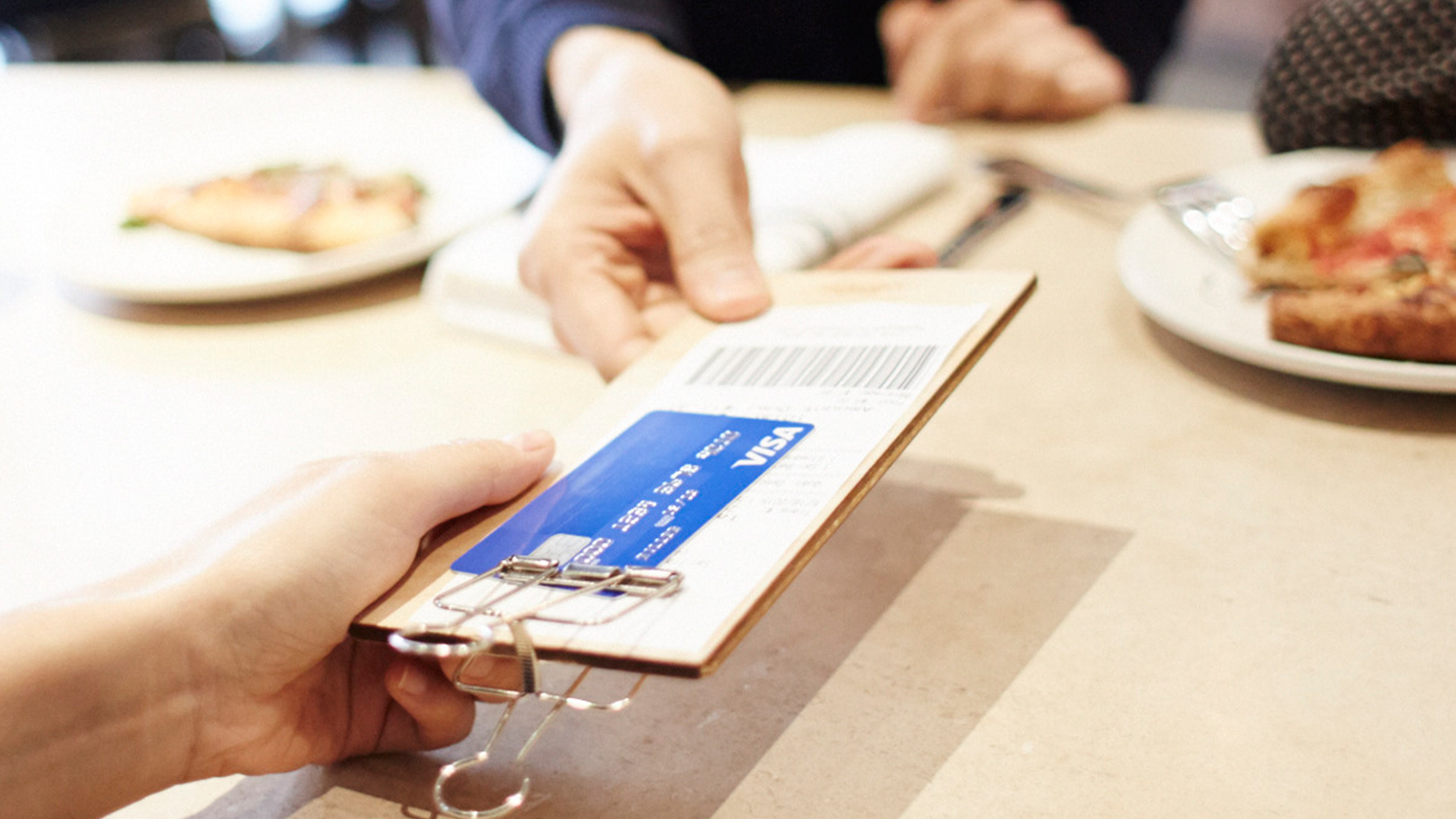 Person paying over a counter