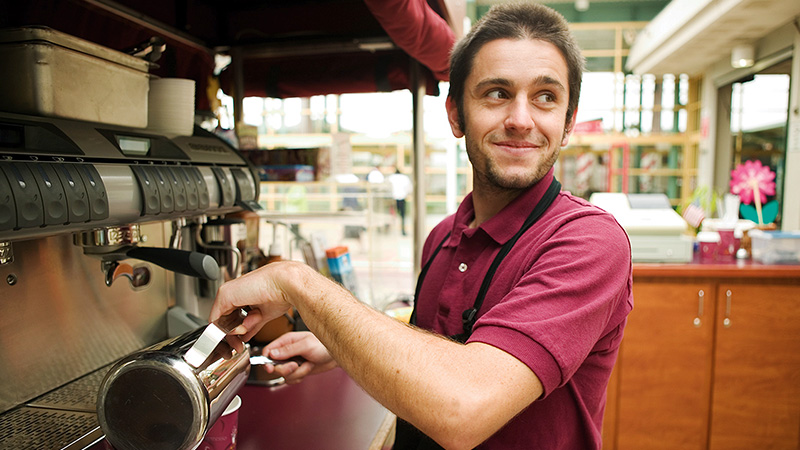 Barista making cup of coffee.