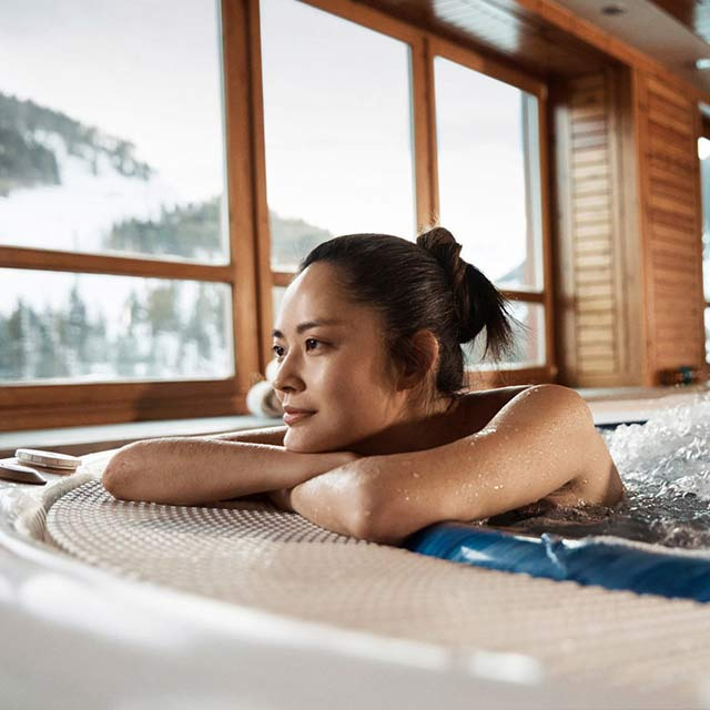 asian lady relaxing in a jacuzzi