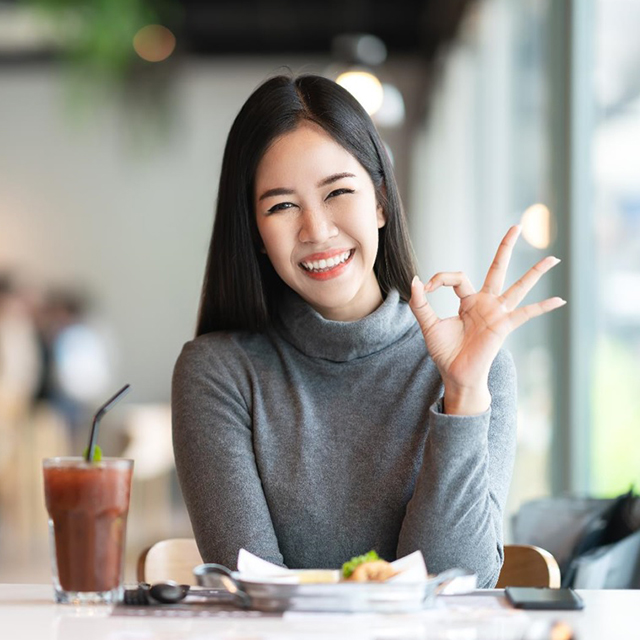 lady giving ok sign
